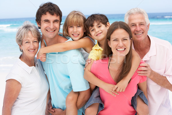 Three Generation Family Relaxing On Beach Holiday Stock photo © monkey_business