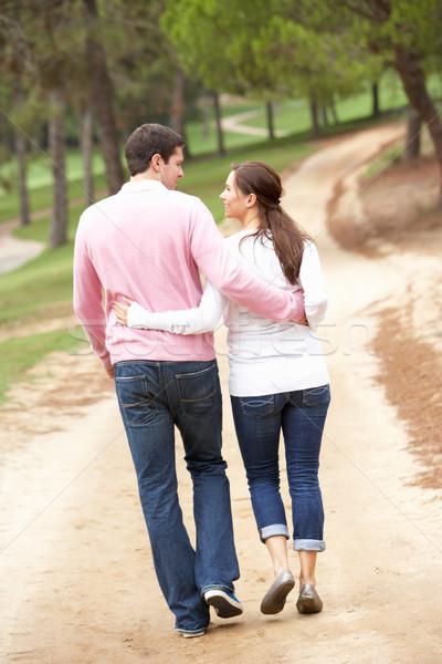Romantikus pár élvezi séta park férfi Stock fotó © monkey_business