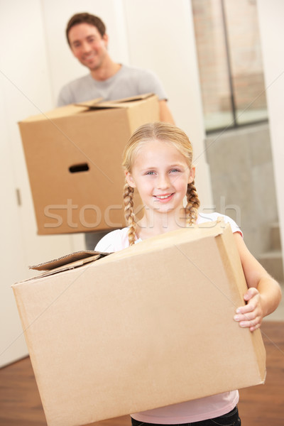 Girl with young man on moving day carrying cardboard box Stock photo © monkey_business
