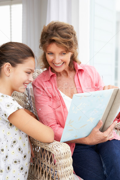Senior woman and granddaughter with photo album Stock photo © monkey_business