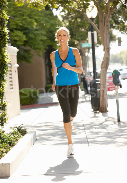 Woman running on city street Stock photo © monkey_business