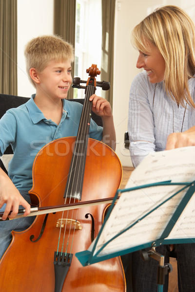 Stock photo: Boy playing cello in music lesson