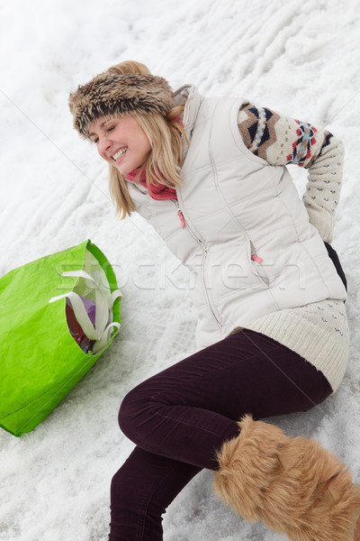 Woman Slipped And Injured Back On Icy Street Stock photo © monkey_business