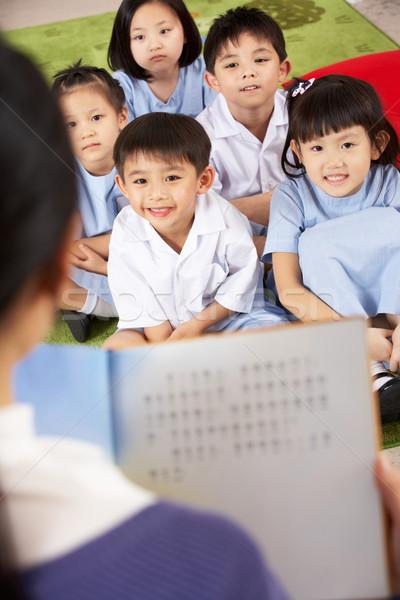 老師 閱讀 學生 中國的 學校 課堂 商業照片 © monkey_business