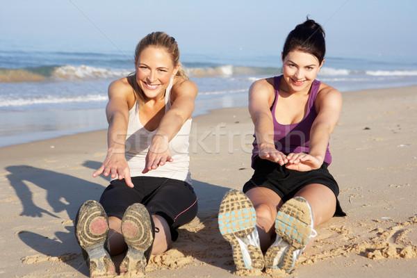Two Women Exercising On Beach Stock photo © monkey_business