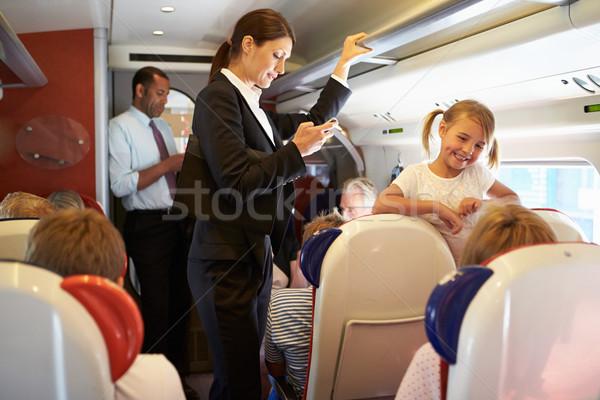 üzletasszony mobiltelefon elfoglalt ingázó vonat nő Stock fotó © monkey_business