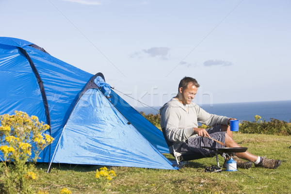 Man camping outdoors and cooking Stock photo © monkey_business