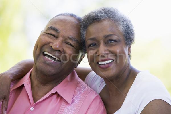 Casal de idosos relaxante fora romântico mulher jardim Foto stock © monkey_business