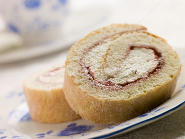 Cream and Strawberry Sponge Roll with Tea Stock photo © monkey_business