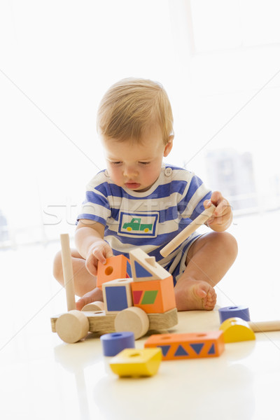Baby indoors playing with truck Stock photo © monkey_business
