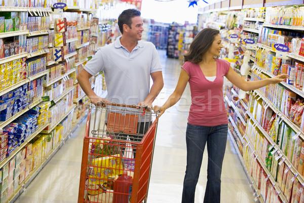 Couple shopping in supermarket Stock photo © monkey_business