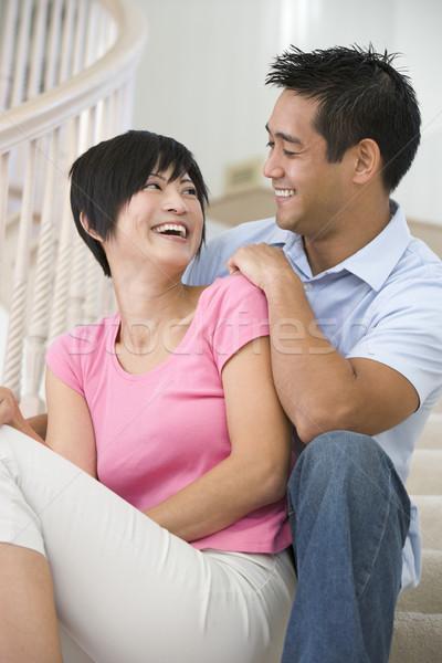 пару сидят лестница улыбаясь женщину лестницы Сток-фото © monkey_business