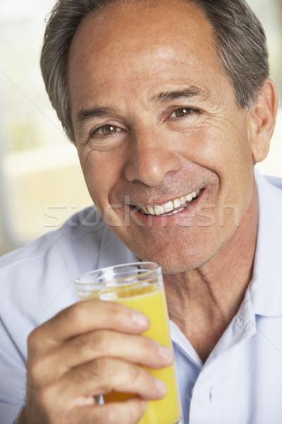 ストックフォト: 飲料 · 新鮮な · オレンジジュース · 男 · ホーム