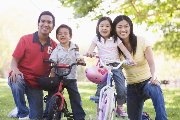 Family with children on bikes outdoors smiling Stock photo © monkey_business