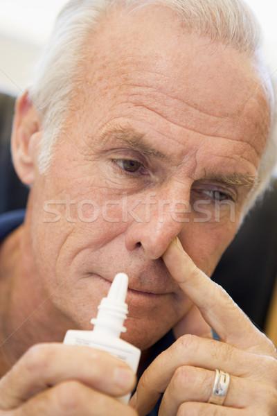 Senior Man Using Nasal Spray Stock photo © monkey_business