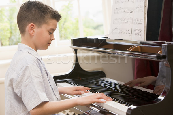 Boy Playing Piano Stock photo © monkey_business