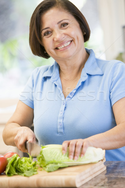 Woman Chopping Vegetables Stock photo © monkey_business