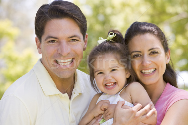 Family standing outdoors smiling Stock photo © monkey_business