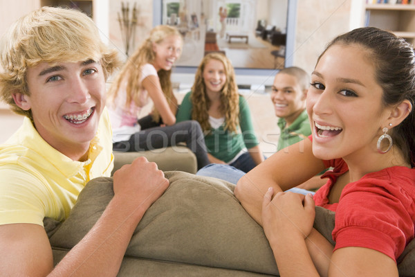 Teenagers Hanging Out In Front Of Television  Stock photo © monkey_business