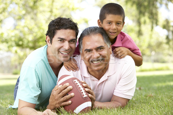 Grandfather With Son And Grandson In Park With American Football Stock photo © monkey_business