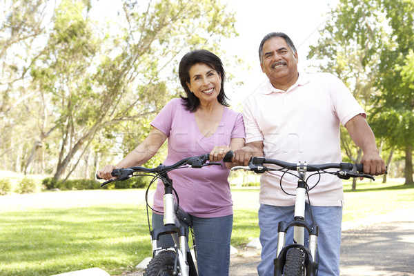 Stock photo: Senior Couple Riding Bikes In Park