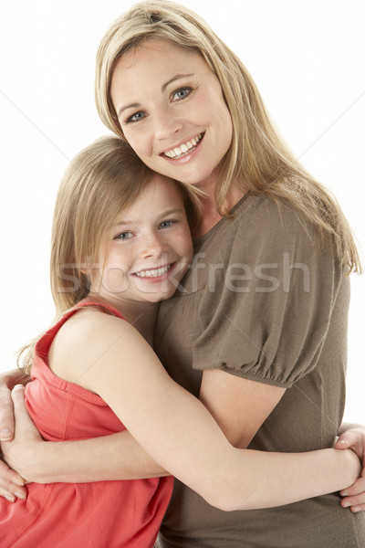 Studio Portrait Of Mother Hugging Young Daughter Stock photo © monkey_business