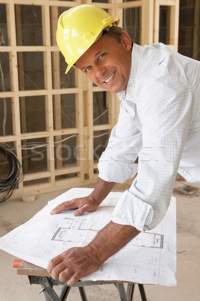 Stock photo: Architect Studying Plans In New Home