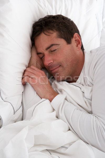 Man Sleeping Peacefully In Bed Stock photo © monkey_business