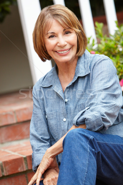 Mid age woman relaxing in garden Stock photo © monkey_business
