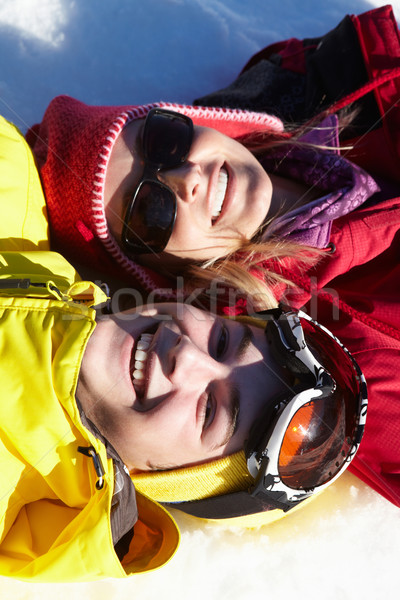 Overhead View Of Mother And Teenage Son Lying In Snow On Ski Hol Stock photo © monkey_business
