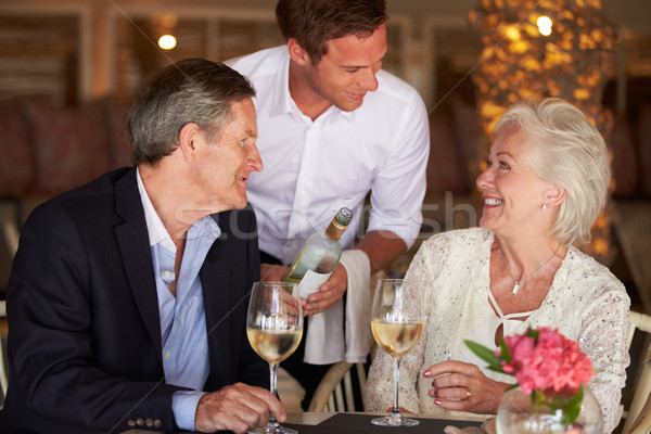 Waiter Serving Wine To Senior Couple In Restaurant Stock photo © monkey_business