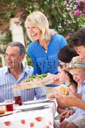 Stockfoto: Familie · genieten · barbecue · voedsel · gelukkig · tuin