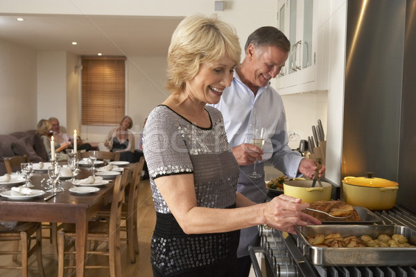 Couple Preparing Food For A Dinner Party Stock photo © monkey_business