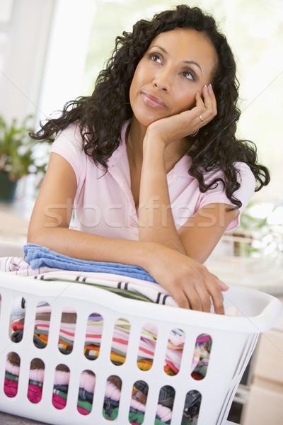 Woman Daydreaming Over Washing Basket  Stock photo © monkey_business