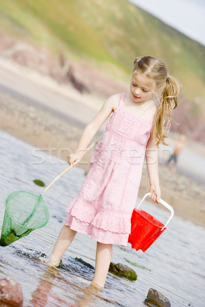 Young girl at beach with net and pail Stock photo © monkey_business