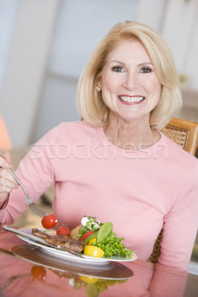 Woman Enjoying Healthy meal,mealtime Stock photo © monkey_business