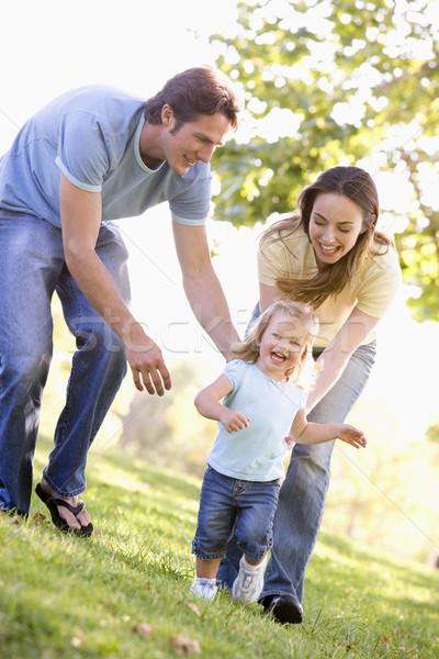 Család fut kint mosolyog lány baba Stock fotó © monkey_business