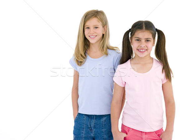 Two girl friends smiling Stock photo © monkey_business
