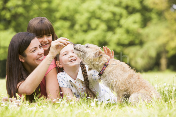 Mother and daughters in park with dog smiling Stock photo © monkey_business