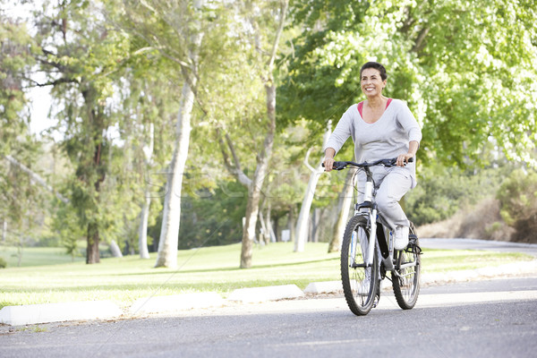 Senior Woman Cycling In Park Stock photo © monkey_business