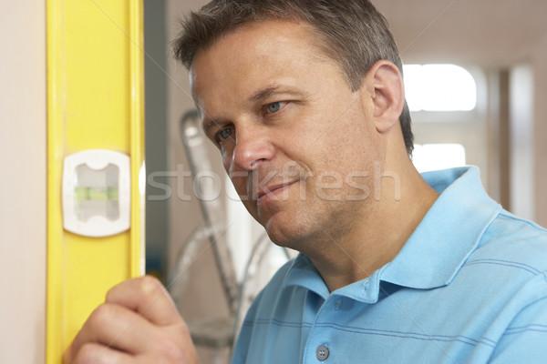 Builder Using Spirit Level On Wall Stock photo © monkey_business