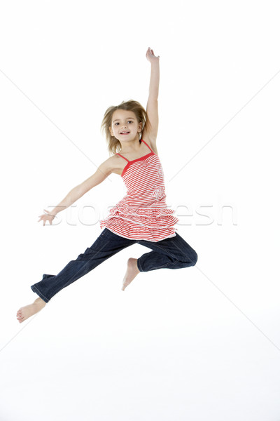 Young Girl Jumping In Mid Air Stock photo © monkey_business