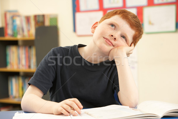 Stock photo: Schoolboy Daydreaming In Classroom
