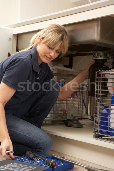 Kadın tesisatçı çalışma batmak mutfak ev Stok fotoğraf © monkey_business