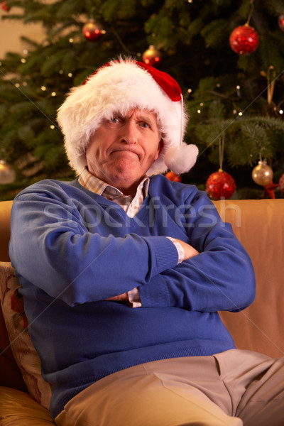 Senior Man Dressed As Father Christmas Looking Grumpy In Front O Stock photo © monkey_business