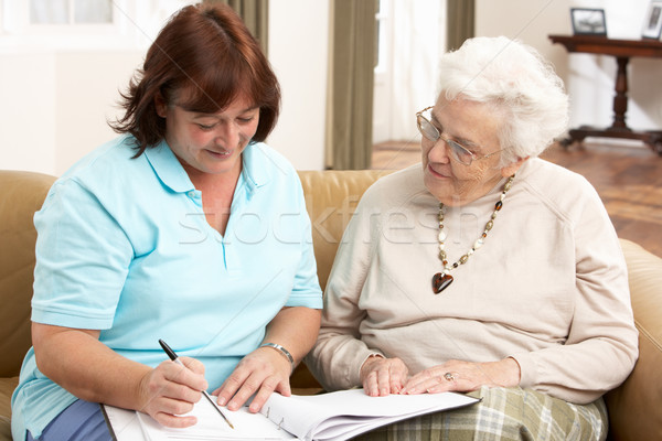 Stock photo: Senior Woman In Discussion With Health Visitor At Home