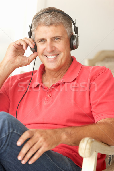 Stock photo: Mid age man wearing headphones