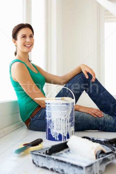 Woman decorating house Stock photo © monkey_business