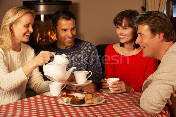 Group Of Middle Aged Couples Enjoying Tea And Cake Together Stock photo © monkey_business