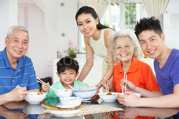 Portrait Of Multi-Generation Chinese Family Eating Meal Together Stock photo © monkey_business